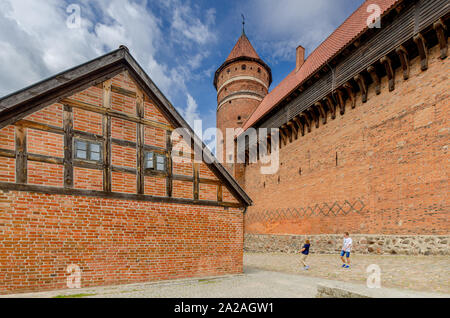 Olsztyn (ger.: Allenstein), Warmian-mazurian province, Poland. 14th cent. gothic castle, former seat of the prince-bishop of Warmia. - Stock Photo