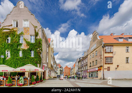 Olsztyn (ger.: Allenstein), Warmian-mazurian province, Poland. The Old Town Marketplace  with the High Gate in the background. - Stock Photo