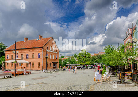 Olsztyn (ger.: Allenstein), Warmian-mazurian province, Poland. The Fish Market plaza, with  the House of the Olsztyn Gazette Museum. - Stock Photo