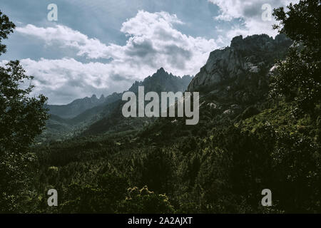 The Aiguilles de Bavella mountains rocky spikes of red granite in the Col de Bavella mountain landscape of the Regional Natural Park of Corsica France - Stock Photo