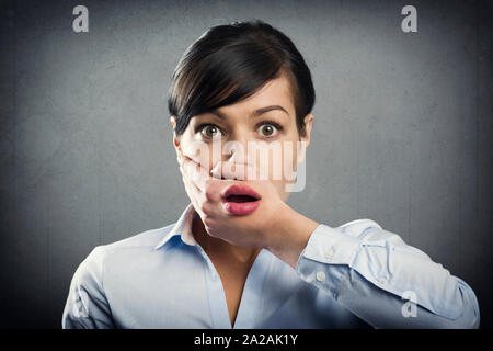 Surprised young businesswoman in shock. - Stock Photo