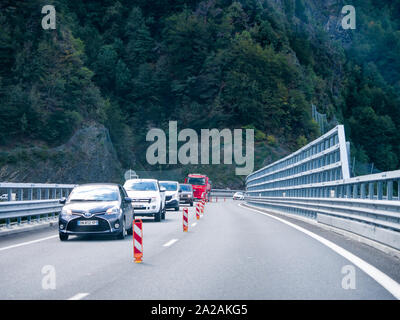 Cars drive on the Egratz viaduct, Chamonix-Mont-Blanc valley, Haute-Savoie, France - Stock Photo