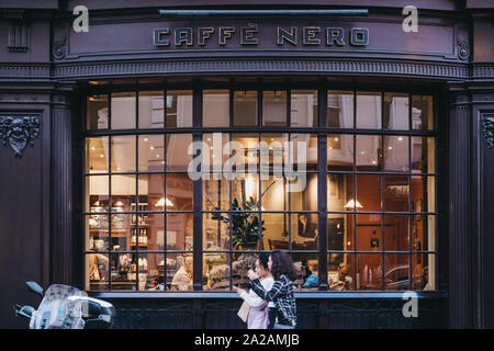 London, UK - August 31, 2019: Facade of Cafe Nero, a British European style coffee house brand headquartered in London, England, people walking by, mo - Stock Photo