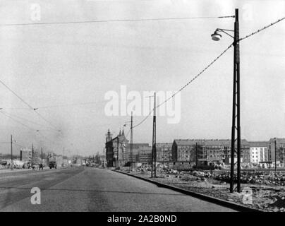 View of a broad street in Frankfurt / Oder, in the background are large residential blocks that are just emerging. - Stock Photo