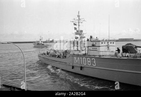 The Lindau class coastal minehunter during an exercise of the  6. Minensuchgeschwader (6th Mine Sweeping Squadron)  at anchor at the port in the North Sea. - Stock Photo