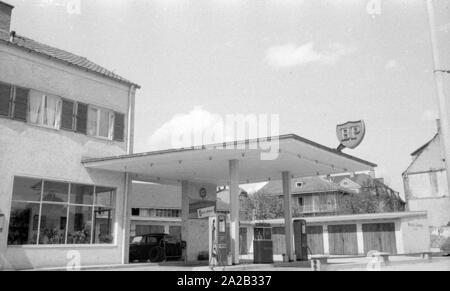 The picture shows a BP gas station in a rural region of Austria, along with some garages. The sign on the flat roof of the gas station and the advertising sign at the entrance show the BP logo from this period. - Stock Photo