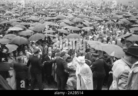 At the annually held Sudeten German Day (earlier: Sudeten meeting) Sudeten Germans from all over the Federal Republic came together. Mostly Bavarian cities were selected for this event, since the majority of Sudeten German expellees settled there. The picture shows a part of the participants protecting themselves with umbrellas from the rain. - Stock Photo