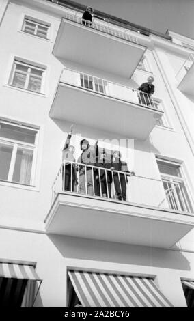 The members of the British band 'The Beatles' on a balcony in Salzburg. From left: Paul McCartney, John Lennon, George Harrison and Ringo Starr. - Stock Photo