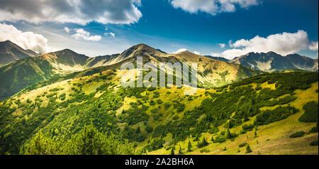Trekking in Tatra Mountains - mountain path from Rakon to Wolowiec summit - Stock Photo