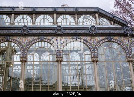 Famous Palacio de Cristal del Retiro - Glass Palace in Buen Retiro Park in Madrid, Spain. - Stock Photo