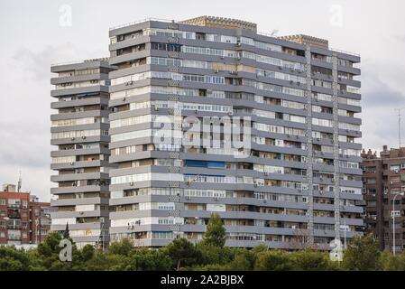 Residential building over Manzanares river in Madrid, Spain, view from Madrid Rio park. - Stock Photo