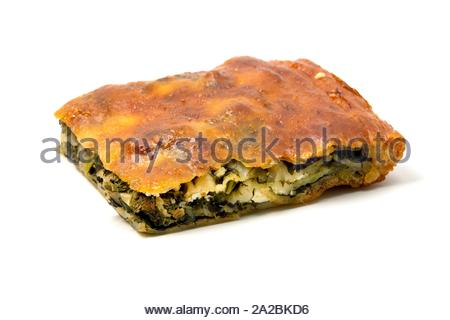Typical Borek with a spinach and cheese filling on a white background. - Stock Photo