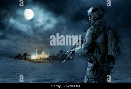 Green Berets US Army Special Forces soldier patrolling desert. Cloudy night, full moon, oasis palace. - Stock Photo