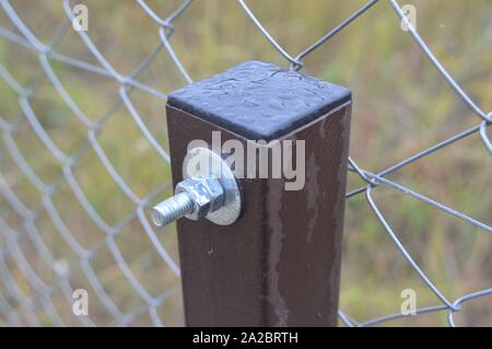 Barbed wire stretched on a fence for security. - Stock Photo