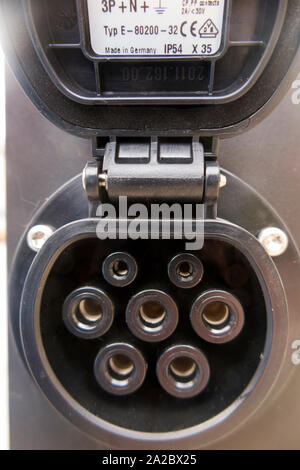 Siemens Ubitricity Simple Socket / Simplesocket with the water resistant cover lifted up, to expose the pin arrangement, on a Victorian style street  lamp / light post / lamp post in London. UK (108 - Stock Photo