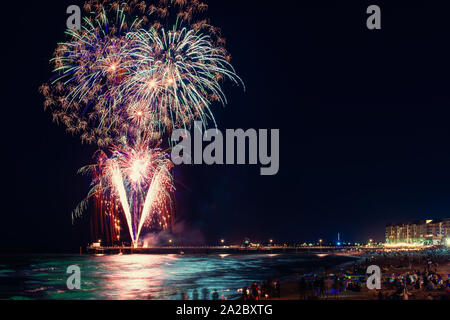 Traditional New Year fireworks display from Glenelg jetty, South Australia - Stock Photo
