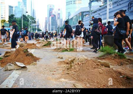 Hong Kong, China. 1st, October 2019. Thousands of pro-democracy protesters march throug several districts of Hong Kong at the 70th anniversary of China's National Day. - Stock Photo