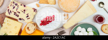 A panorama of cheeses, shot from the top. Cheese platter flat lay - Stock Photo