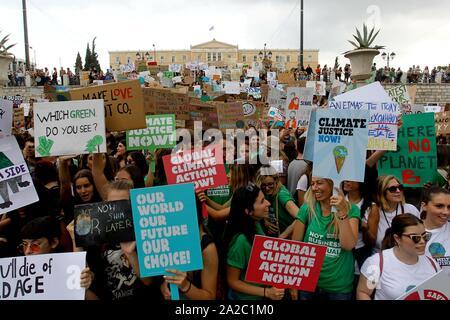 Climate protesters demonstrate in the center of Athens. Protesters around the world joined rallies on Friday as a day of worldwide demonstrations calling for action against climate change began ahead of a U.N. summit in New York. - Stock Photo