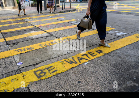 October 2 2019.  Hong Kong resumes business the morning after violent protests on October 1 2019. Buildings and roads were written with political slogans.and grafitti. - Stock Photo