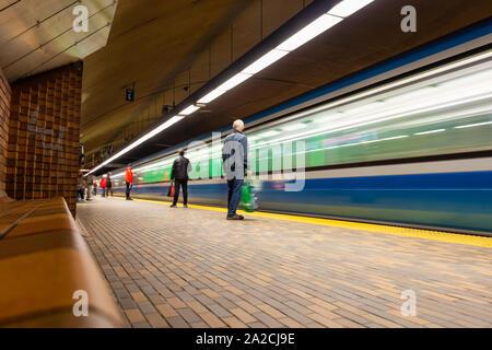 Montreal, CA - 30 September 2019: Subway train arriving at Mont-Royal Station. - Stock Photo