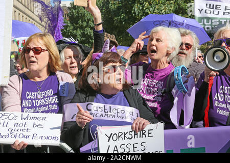 Manchester, UK.2nd October, 2019. Women Against State Pension Inequality send a message to Boris Johnson who is in the city to speack at the Tory Party Conference. Chanting 'We vote too'  as delegates from the Tory conference walk past after listening to Boris Johnsons speech. The WASPI Women will find out the results of a landmark court ruling later in the week.  St Peters Square, Manchester, Lancashire, UK. Credit: Barbara Cook/Alamy Live News - Stock Photo