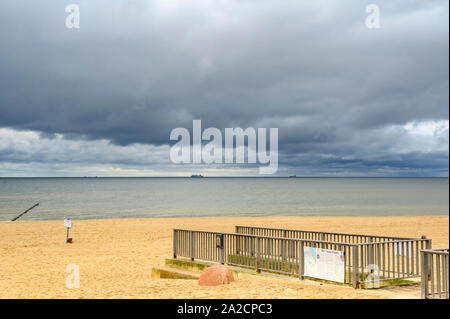Bansin, Germany - September 13, 2019: Lonely beach on Usedom with view over the sea to dramatic looking storm clouds. - Stock Photo