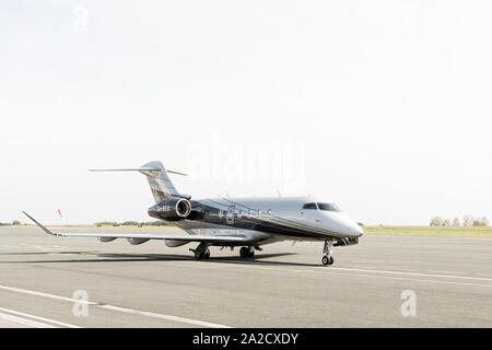 Bombardier Challenger 350 private jet parked on the tarmac at Biarritz Airport, France. - Stock Photo