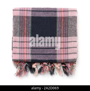 Top view of folded plaid cloth with tassels isolated on white - Stock Photo