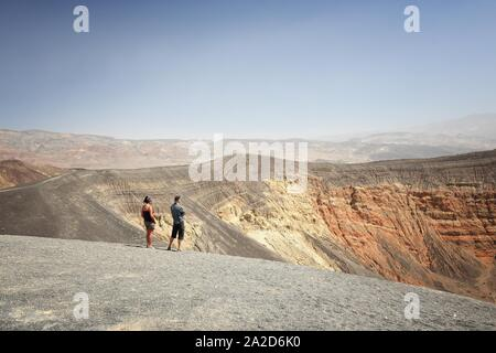 DEATH VALLEY, USA - APRIL 13, 2014: Tourists visit Ubehebe Crater in Death Valley, California. Death Valley National Park was visited by 951 thousand - Stock Photo