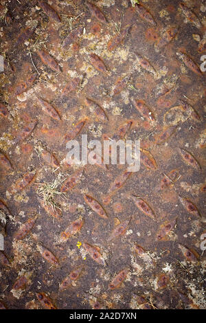 Rusty old metal floor cover with pattern detail - Stock Photo