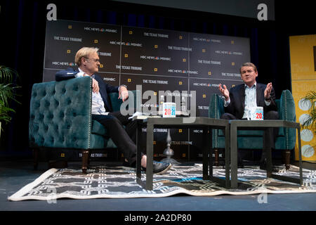 Sen. Michael Bennet, right, (D-Colorado) talks about his presidential aspirations with MSNBC political commentator Lawrence O'Donnell during a Texas Tribune Festival session. - Stock Photo