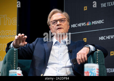 MSNBC political commentator Lawrence O'Donnell gestures while interviewing U.S. Sen. Michael Bennet of Colorado during a Texas Tribune Festival session. - Stock Photo