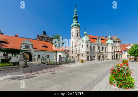 Pszczyna (ger.: Pless), Silesian province, Poland. Gate of the Privileged. Lutheran church, the city hall; Marketplace square. - Stock Photo