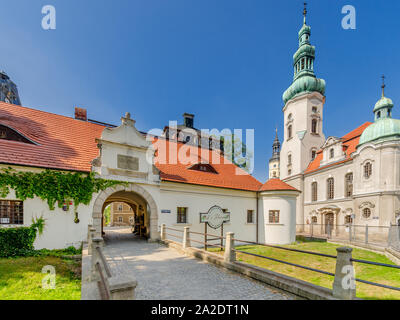 Pszczyna (ger.: Pless), Silesian province, Poland. The Gate of the Privileged - entrance to the castle's park, Lutheran church at the - Stock Photo
