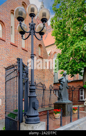 Oswiecim (ger.: Auschwitz), Lesser Poland province.  Statue of the saint John Bosco on thefront of the Saint Hyacinth chapel, W - Stock Photo