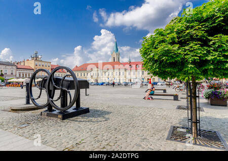 Oswiecim (ger.: Auschwitz), Lesser Poland province.  Old well with reconstructed water pump, Main Market square. - Stock Photo