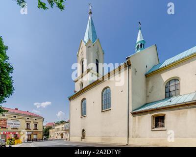 Oswiecim (ger.: Auschwitz), Lesser Poland province. Jaroslawa Dabrowskiego street, belfry of the Church of the Assumption of t - Stock Photo