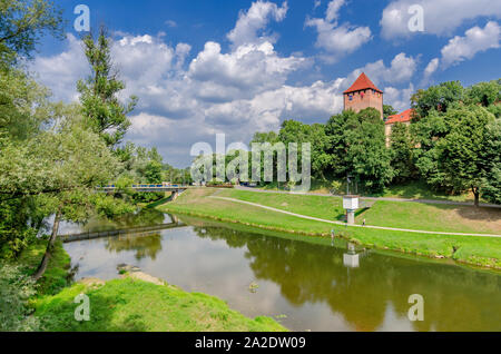 Oswiecim (ger.: Auschwitz), Lesser Poland province.  View of the riverbank of Sola river with fortified tower of the castle. - Stock Photo