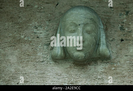 Umea, Sweden - September 4, 2019: an old spooky statue head above a door at Umedalen - Stock Photo