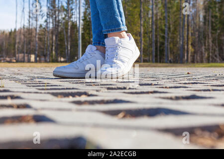 Girl stands on modern urban paving stones