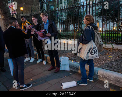 London, UK. 2nd October 2019. A small group of representatives of English PEN, Writers at Risk, Reporters Without Borders and PEN International hold a candlelit vigil at the Embassy of Saudi Arabia on the first anniversary of Saudi journalist Jamal Khasnhoggi's  horrific murder inside the Saudi consulate in Istanbul where his body was dismembered. The event was opposed by a larger group of Saudis who kept mainly on the opposite side of the road but some came to stand in front of them. Peter Marshall/Alamy Live News - Stock Photo