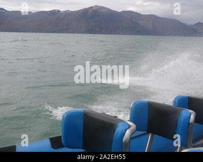 View of a RIB on a choppy sea in the Skjalfandi Bay on a whale-watching trip from Husavik on Iceland's northern coast. - Stock Photo