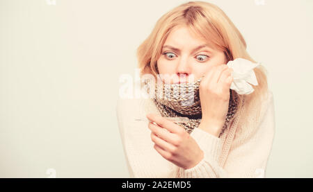 Break fever remedies. Seasonal flu concept. Woman feels badly. How to bring fever down. Fever symptoms and causes. Sick girl with fever. Girl sick hold thermometer and tissue. Measure temperature. - Stock Photo