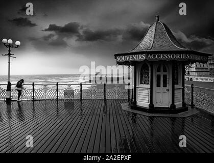 A wind and rain-swept kiosk on Brighton Palace Pier, opened in 1899 in Brighton, Sussex, England. - Stock Photo