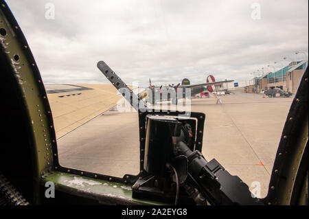 Inside Collings Foundation's B-17G Flying Fortress, Nine-O-Nine, looking out at Worcester Regional Airport for Wings of Freedom event. - Stock Photo