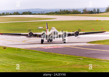 Collings Foundation's B-17G Flying Fortress, Nine-O-Nine, at Worcester Regional Airport for Wings of Freedom event. - Stock Photo