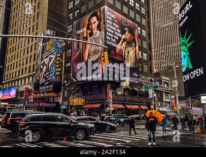 New York City, U.S.A, May 2019, urban scene on a raining day on the 7th Ave & W 48th St, Manhattan - Stock Photo