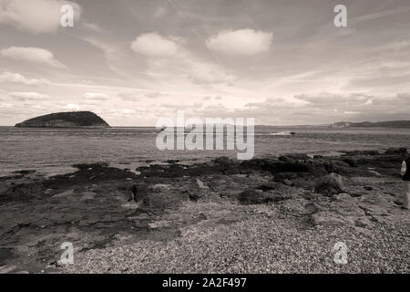 The eastern extremity of Anglesea showing the passage between the shore and Puffin island containing Penmon lighthouse - Stock Photo