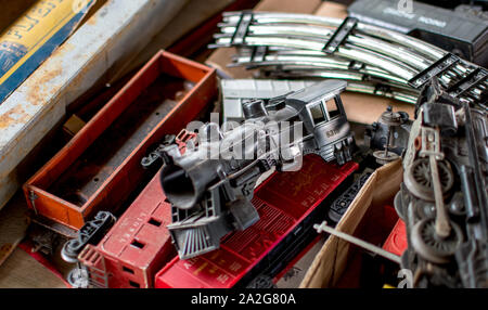 Hesston Indiana USA August 31, 2019; a box of model trains and parts are for sale at a flea market - Stock Photo